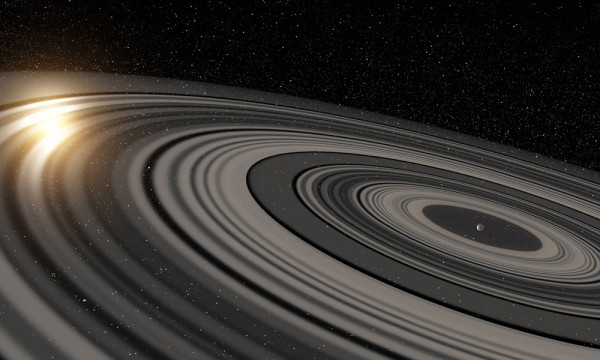 Distant Ringed World Dwarfs Those of Saturn